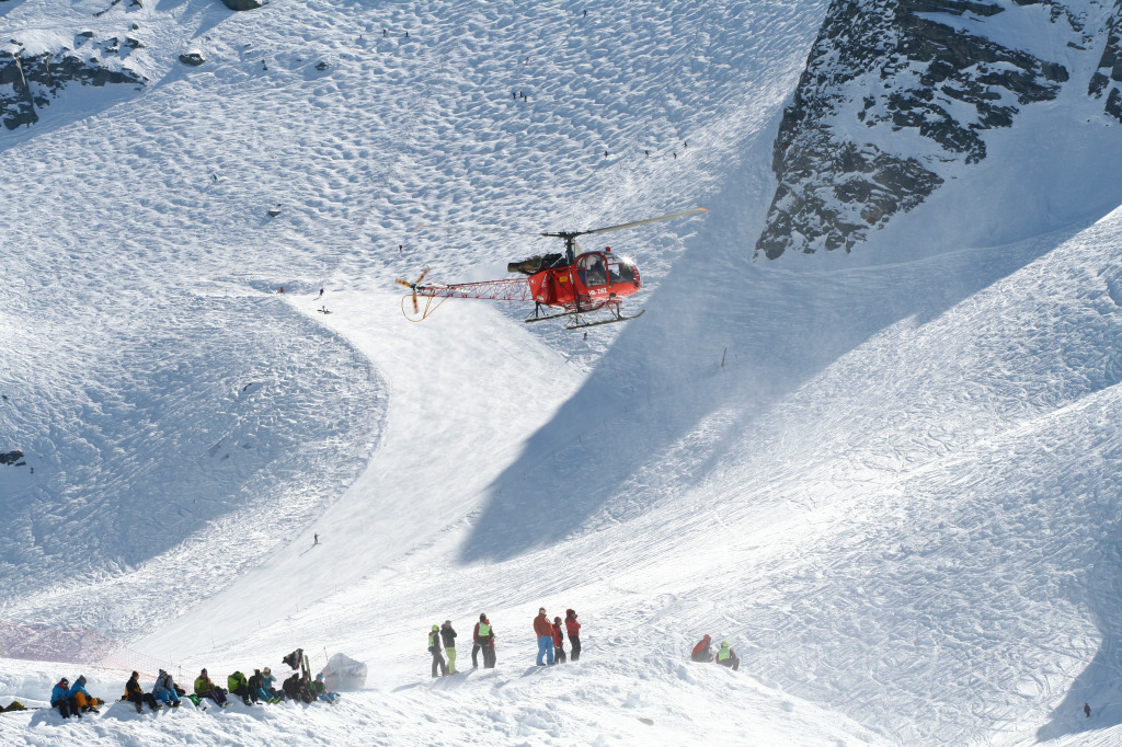 A helicopter flies through a run in Verbier, Switzerland.